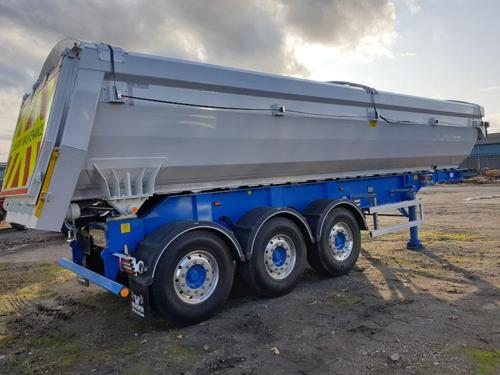 Aggregate Tipping trailer. Straight frame with alloy Half barrel body and air locking taildoor with auto sheet.