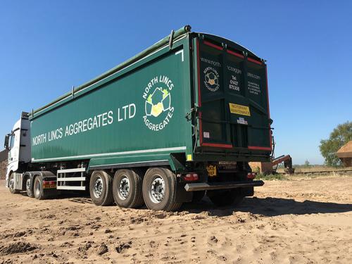 Bulk tipping trailer, Sloper frame chassis, Plankside, Sloping forward headboard, air locking taildoor.